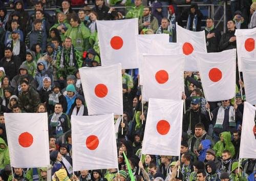 Fans of the Seattle Sounders FC hold signs in honor of victims of the  recent earthquake in Japan prior to the game against the Los Angeles  Galaxy at Qwest Field on Wednesday, March 15 in Seattle.  Photo: Otto Greule Jr / Text & Image: MSNBC World Reaction