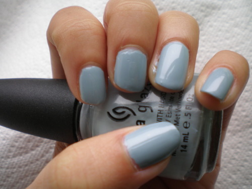 Sea Spray by China Glaze Reflective of the dreary weather, Sea Spray is a gorgeous piece from China Glaze's Anchors Away collection. It's a creme with barely-there shimmer. It's pale blue and almost dove gray. But what it really is is absolutely lovely. Given my well established delight in delicate pale colors, perhaps my take isn't such a surprise. Although I would hesitate to wear Sea Spray at a conservative office, it is subtle enough to be paired with virtually any outfit.