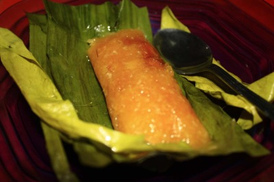 Lemet Made of cassava, coconut, and palm sugar. Mixed, wrapped in banana leaf, and steamed.