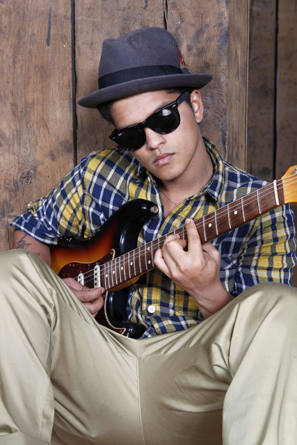 alwaysbrunomars:  that serious look when his lower lip protrudes a lil bit more than usual.