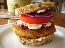 Chickpea Burgers 1    carrot (medium size grated)  1    garlic clove  1 (19 ounce) can chickpeas  1 1/2 teaspoons ground cumin  1 1/2 teaspoons ground coriander  salt & pepper  1  large egg (or two egg whites) 2  tablespoons plain flour  oil (just enough for cooking; oil spray is fine) Peel the carrots, grate them coarsely and set them aside. Peel and roughly chop the garlic.  Drain and rinse the chickpeas and put them into a food processor with the garlic, ground spices, salt and pepper.  Slightly process to obtain a rough paste then add the carrot, egg, and flour and process briefly until evenly mixed but slightly rough.  Heat the oil in a frying pan and divide the mixture into 8.  Fry in batches for 2-3 minutes on each side, until golden, then drain on kitchen paper.  Makes eight burgers, 128 Calories each. *For vegans, combine 1 tablespoon ground flax with 2 tablespoons boiling water (make this separately first, please) to replace the egg (or whatever egg replacement you have — it's the binding agent here).  I broke mine moving it onto a napkin, but it's still delish. I didn't have ground coriander, so I added some taco seasoning and hot sauce to the mix. My roommate likes them too, and he's a meat and potatoes kind of guy.