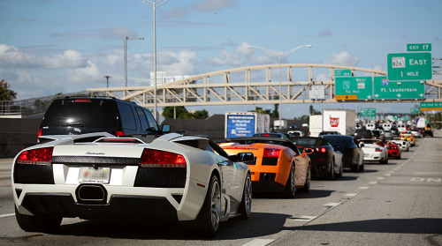 carpr0n:  Being stuck in the traffic never looked so good Starring: Lamborghini Murcileago & Gallardo, Ferrari F430 & 360 and Porsche 911 (by whimsicalallure)  …or felt so much like a prison.