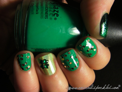 "nailaddicted:  http://www.emeraldsparkled.com  NOTD: St. Patty's Day    From the source: ""On my ring finger I have China Glaze L8R G8R, and four green heart-shaped rhinestones, forming a four leaf clover. On my thumb I have Illamasqua Rampage, with Zoya Ivanka sponged on the upper half. On the rest of the nails I have China Glaze Four Leaf Clover, with gold sequins from Viva La Nails on top…"" That is a NICE holo green on the ring finger. Want. Best China Glaze collection ever!"