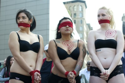 The main event. Three activists standing bound and gagged to highlight the oppression faced by sex workers.