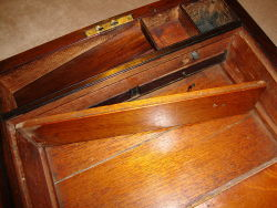 Antique desk with hidden compartment - A false panel conceals two secret drawers