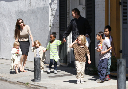 suicideblonde:  The Jolie-Pitt family out in New Orleans yesterday.