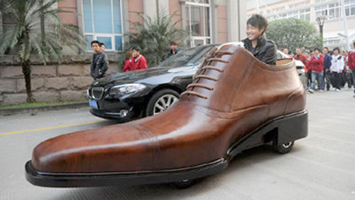 ianbrooks:  Electric Shoe Car A footwear manufacturer in China has made an electric car out of a giant shoe. It can carry two people up to 250 miles at speeds of up to 20mph on a single charge of the battery underneath the driver's seat. I'd hate to see the odor eater designed for that thing. In related news, Mario preparing to sue:  (source: gizmodo)  Tomorrow: a discussion about the future of the electric car — and the batteries needed to power them — with science writer Seth Fletcher