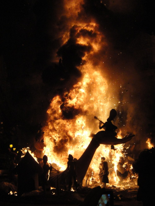 These are Las Fallas! An incredible celebration in Valencia where fireworks and firecrackers con all day long. The maximum interval between explosions nearby or in the distance is around 4-5 seconds. The crowds are so packed together at times you can't move.  The art criticizes and laughs at society. There are more flowers in one plaza than you'll ever see in your life. And the fires are so big it feels like your face is melting. AWESOME!