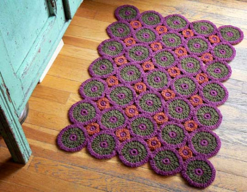 Great idea for a kitchen or a bathroom throw rug. Simple enough to do. Here's a splendid tutorial on how to crochet in the round. After amassing a pile of circles, all you'll do is connect them with a couple of slip stitches. And BOOM! There you go.