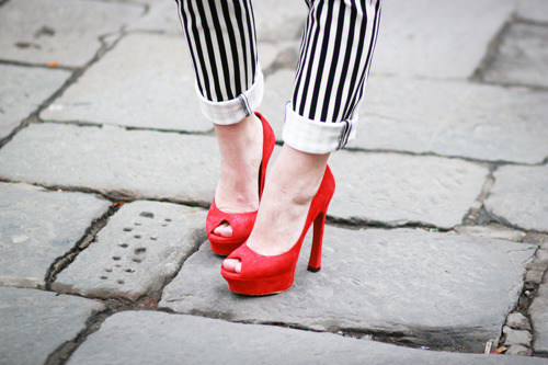 couturecourier:  Mmm, Red Yves Saint Laurent pumps and cute Balmain pants! (via Le Blog de Betty)