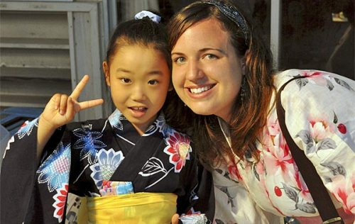 Taylor Anderson, right, with one of her students in Ishinomaki, Japan, where she taught English. She is the first American found dead after the Japan earthquake. Credit: Anderson Family / Associated Press / July 17, 2010