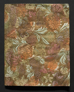 "kirtha:  Dutch temporary binding of gilt embossed paper, 17th century. "" Many early books were issued in temporary or interim covers by the  printer/publisher or bookseller. These covers could then be replaced by a  permanent binding of the purchaser's choice. Temporary bindings often  have untrimmed text edges and may be stab-stitched rather than sewn.  Because of their flimsy nature these covers have not survived in large  numbers. This temporary binding  of Dutch gilt embossed paper is a thing of beauty in its own right. In  making this paper, an engraved roller or wooden block was used to  impress the pattern on a sheet of paper coated with size, a substance  that helps to prevent the absorption of liquids and improves the paper's  surface. Before it dried, gold dust was applied and colours were dabbed  or stencilled on. Although called Dutch papers, they were probably made  in Germany."" From the collections of the National Library of New Zealand."