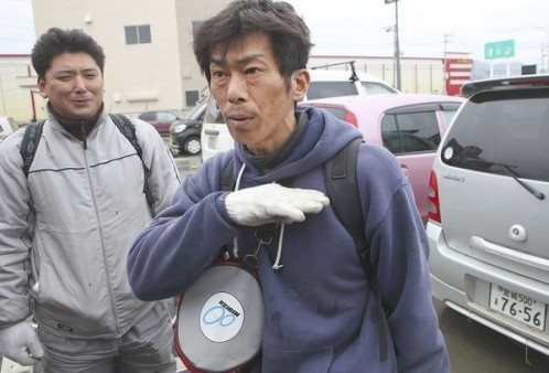 toliveanddieinlondon:  This is Hideaki Akaiwa. When the Tsunami hit his home town of Ishinomaki, Hideaki was at work. Realising his wife was trapped in their home, he ignored the advice of professionals, who told him to wait for the army to arrive to provide search and rescue. Instead he found some scuba gear, jumped in the raging torrent - dodging cars, houses and other debris being dragged around by the powerful current, any of which could have killed him instantly - and navigated the now submerged streets in pitch dark, freezing water until he found his house. Swimming inside, he discovered his wife alive on the upper level with only a small amount of breathing room, and sharing his resperator, pulled her out to safety. If he had waited for the army, his wife of 20 years would be dead. Oh, and if that's not enough badassery for one lifetime, Hideaki realised his mother was also unaccounted for, so jumped back in the water and managed to save her life also. Since then Hideaki enters the water everyday on a one man search and rescue mission, saving countless lives and proving that two natural disasters in a single day, and insurmountable odds can't stand in the way of love. This man is my hero.