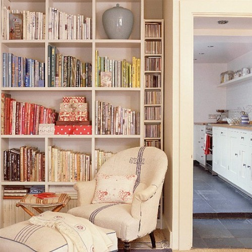 (via Living room with bookshelves and armchair | housetohome.co.uk)