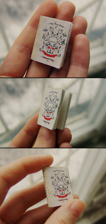 hitrecordjoe:  hitrecord:  The Tiniest Book of Tiny Stories created by moonterra   2 x 3 cm - onionskin paper, watercolor paper, carbon paper, glue, black & red ink, multiliner pen, watercolor  And, you can purchase the less-tiny-but-still-tiny Tiny Book of Tiny Stories here! :O)
