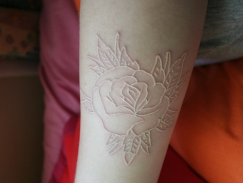 Holy, white tattoo's are gorgeous. I may have to get the paw print tattoo's I want on my wrist in white instead of black, because they look like paler raised skin, fantastic.