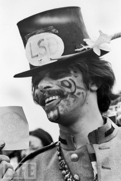 "oldnewyork:  A hippie advertises LSD during a ""be-in"" in New York's Central Park, 1968."
