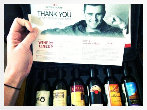 Nora's Gary Vaynerchuk wine sample pack that she redeemed for .2 cents via Tasting Room as a Thank You at his SXSW panel arrived today. She's a little excited, to say the least.