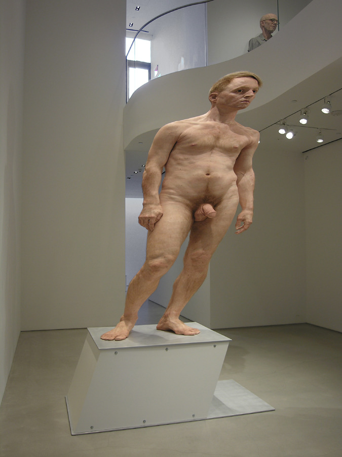 "The Awkward Joys of Anamorphosis by Daniel Larkin A towering nude man greets every visitor to Sperone Westwater gallery on the Lower East Side. This ten foot tall figure, also known as ""Jim Revisited"", made in 2011, looks so realistic that it stops nearly everyone dead in their tracks upon entering the gallery. The people-watching is great as viewers trade surprised glances and funny comments, all while staring wide open with disbelieving eyes. This is the type of art that boggles the mind; it provokes the question of how the hell the artist pulled it off. Rattling off the list of banal materials — silicone, pigment, hair, aluminum and fabric — does little to capture the convincing illusion that artist Evan Penny conjures, but it does testify to his deft artistic mind that achieves much more than most with these materials…. READ MORE."