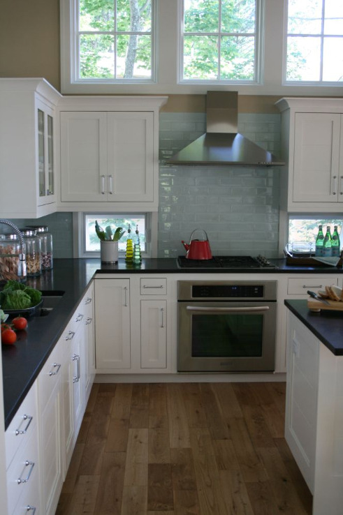 fab woord flooring and kitchen tiles. the small windows are so creative!