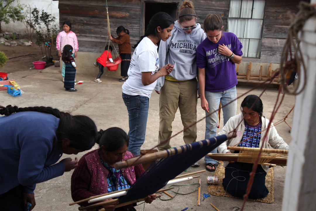 BLUElab student members watch as the Guatemalan women weave material for the prototype of a wind turbine the students are developing. The students work with Guatemalan women weavers on Woven Wind Turbine project in a Guatemalan village of Nueva Santa Catarina Ixtahuacán.  University of Michigan students are designing a wind turbine that uses locally weaved material for wind blades. The students hope that local women in Guatemala will be able to use current weaving skills to generate income and electricity.  Nueva Santa Catarina Ixtahuacán.  The students are Sonya Kavalam, Maggie Pistella and Gina McGauley. Guatemalan women include Cleotilde Lopez (first right).  Tuesday, March 1,  2011. Photo by Marcin Szczepanski, Multimedia Content Producer/CoE's Communications and Marketing