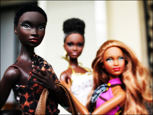 "Image: Three Black Barbies So here's the thing. I know how many women feel about Barbie. I know how many black people feel about Barbie. But when I was a little girl, I loved my Barbies. I would act out elaborate storylines with them. And the dolls I asked for specifically weren't always the princess dolls (in fact, I don't think I ever asked for or had one). I wanted the dolls that did cool things. Like Astronaut Barbie, who went to the moon, and Day to Night Barbie, who worked in an office like my mom but still went out at night with Ken. Unlike my mom, Barbie did not have a kid to care for. Most of my Barbies were white, yes, but my mom and family made sure I had some black Barbies that weren't just cocoa-colored versions of the ""regular"" doll. When I grew up and started collecting Barbies, I found that the world of black Barbies is full of gorgeous, gorgeous dolls wearing kick-ass fashions that do have the features of women with African blood. Mattel may not be on the list of most sensitive companies of all time, but when they set out to create some beautiful black dolls for girls, they did not play around. If I can dig them out, I'll post the pictures I took at Toy Fair celebrating 30 years of Black Barbie."
