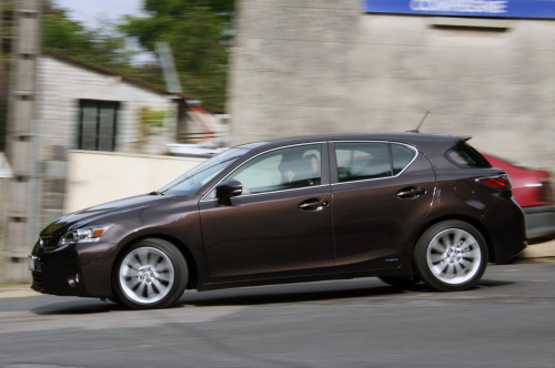 "2011 Lexus Ct 200h  Yes, it's Lexus' Corolla. Yes, it's an unholy mashup of a Prius, and and ES300. And yet I don't hate it. Well, I don't hate it except for the upward cut on the rear door that's a ""feature"" of the IS200, too. Yuck.  Actually, you know what would be better would be the Ct 200h drivetrain in an ES300. I always liked those. They seemed like the perfect expression of being in Business Class on a trans-pacific trip. A nice place to spend the time, but you don't miss it when you leave.  /via autoblog  PS: Hey, is that a Renault 19 back there?"