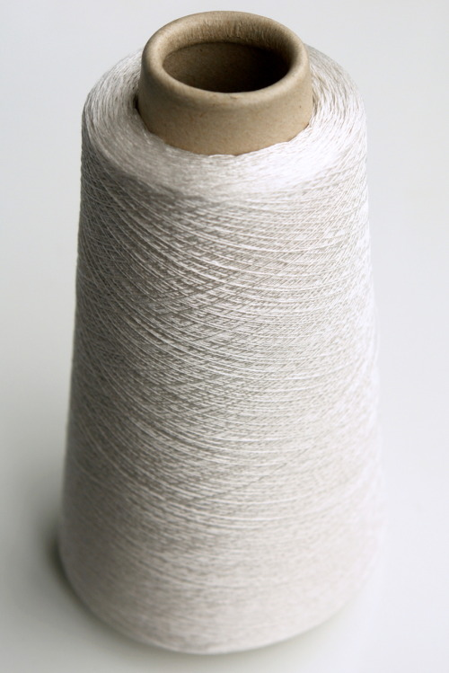 Cone of silk yarn.  Imagine the possibilities.