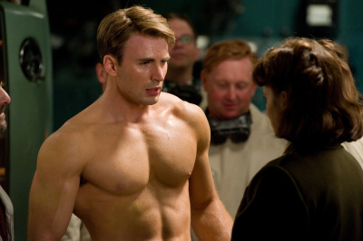 Chris Evans is Captain America!  When will I have a body like this?  NEVER!!!