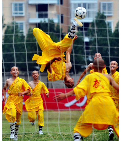 I never knew Shaolin Soccer was a real thing (and not just a bad movie). afternoonsnoozebutton:   KICKY SITUATION   Shaolin monks show off their football soccer skills during a demonstration game in Dengfeng, central China's Henan province.  (Photo: AFP-Getty via the Telegraph)  via mohandasgandhi:inothernews