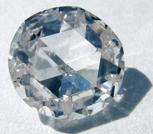 "Flawed Diamonds Could Store Quantum Data  Scientists have developed a new way to manipulate atoms inside diamond crystals so that they store information long enough to function as quantum memory, which encodes information not as the 0s and 1s crunched by conventional computers but in states that are both 0 and 1 at the same time. Physicists use such quantum data to send information securely, and hope to eventually build quantum computers capable of solving problems beyond the reach of today's technology.  For those developing this quantum memory, the perfect diamonds don't come from Tiffany & Co. — or Harry Winston, for that matter. Impurities are the key to the technology.  ""Oddly enough, perfection may not be the way to go,"" said David Awschalom of the University of California, Santa Barbara. ""We want to build in defects.""  One of the most common defects in diamond is nitrogen, which turns the stone yellow. When a nitrogen atom sits next to a vacant spot in the carbon crystal, the intruding element provides an extra electron that moves into the hole. Several years ago, scientists learned how to change the spin of such electrons using microwave energy and put them to work as quantum bits, or qubits.  In search of a more stable way to store quantum information, Awschalom has now figured out how to link the spin of a electron to the spin of the nearby nitrogen's nucleus. This transfer, triggered by magnetic fields, is fast — about 100 nanoseconds, comparable to how long it takes to store information on a stick of RAM."