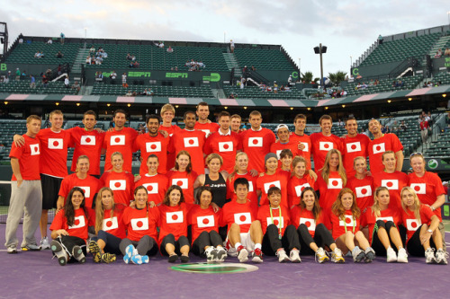 "Members of the ATP and WTA who are participating in the Sony Ericsson  Open pose for a group photo as part of ""Tennis Family for Japan Relief""  during the Sony Ericsson Open at Crandon Park Tennis Center on March 25,  2011 in Key Biscayne, Florida. Source"