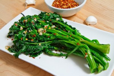 Broccoli rabe, also known as broccoli rappi, rappi greens, rappini, and asian broccoli. In western cuisine it's traditionally served like this, sauteed with onions and red pepper flakes, but it has nearly unlimited applications.