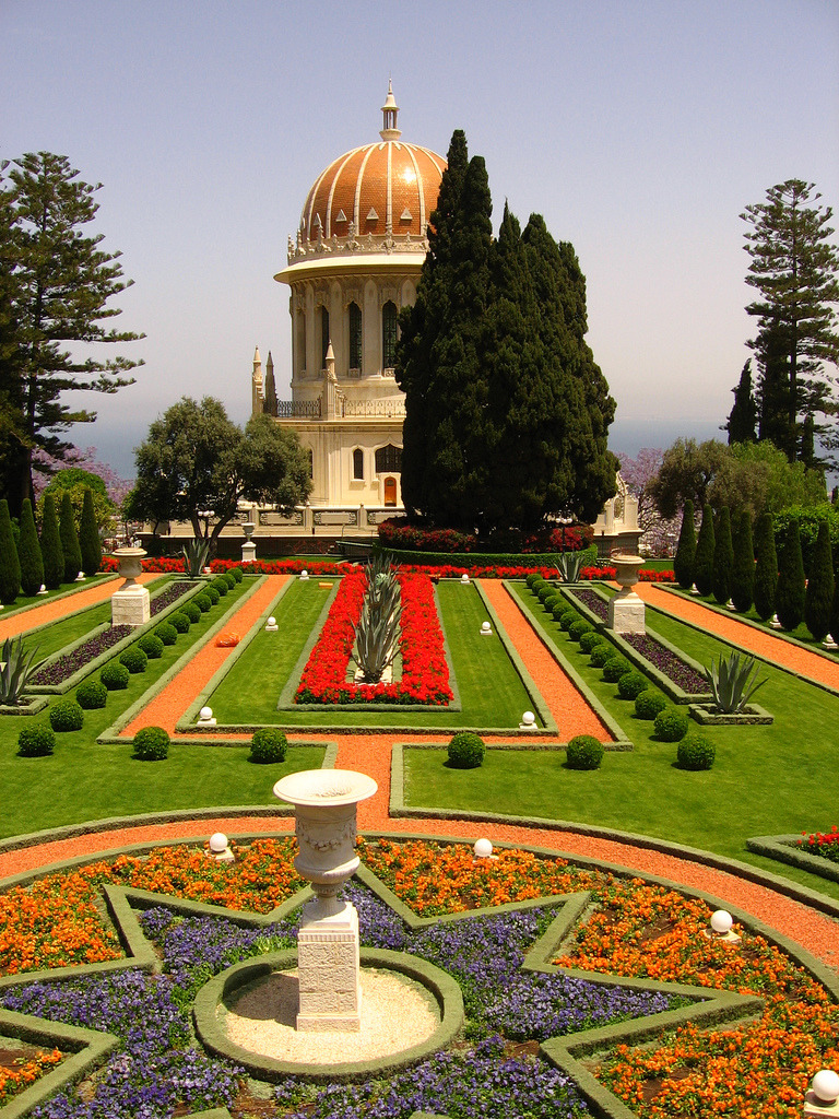 "Discovering the Bahá'í Gardens by Janine Rayford, USC ""Reporting on Israel"" Journalism Student ""Wow, what is that?"" This question sprang from my mouth the moment I first saw the Bahá'í Gardens in Haifa, Israel. My classmates and I had just gotten off of the bus in the German Colony area and were on our way to a restaurant that sits on the street just below the breathtaking monument. Since it was nighttime, all I could make out was an organized pattern of lights seeming to ascend into the sky. I had never heard of the Bahá'í Faith prior to my visit to Haifa. After a bit of research, I found out that Bahá'í is a relatively new monotheistic religion founded in nineteenth-century Persia and that the Bahá'í Gardens (or Terraces of the Bahá'í Faith, or Hanging Gardens of Haifa) are gardens that surround the Shrine of Bab. Bab was the founder of Babism and forerunner to the Bahá'í Faith.  Intrigued by this new information, I decided to get a daytime look and spend my lunch hour at the brilliant edifice. The gardens are a landscaper's dream (or nightmare, in terms of upkeep). Layers upon layers of perfectly manicured lawns, sparkling fountains, and pruned foliage scale the side of Mount Carmel. Guided tours take awestruck visitors from all faiths up and down the stairs and throughout the flower-lined terraces. A colleague and I listened in on one tour guide as she described how the Israeli government dealt with the Bahá'í community during the establishment of the Jewish state. Holy places, like the Bahá'í Gardens, would be preserved, but the Bahá'í had to stop their missionary activities and limit for the number of followers allowed to remain in the new nation. Leaving the gardens, I couldn't help thinking that in Israel, religious politics plays a part in everything, even the flowers. (photos by Ron Almog) Editor's note: Krista and the On Being team are in Israel    this week and working with Diane Winston's graduate students from the    University of Southern California Annenberg School of Communication    & Journalism. We'll be sharing some of these students' reports as     part of our collaboration and to add to the diversity of observations  of   this complex place."