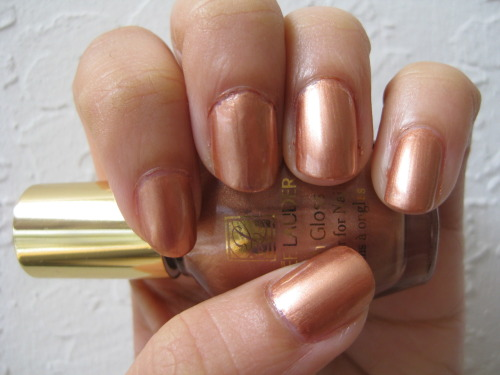 Bronze Medal by Estee Lauder This sun warmed bronze color is ideal for subtly dressing up any summery outfit. Although it's a metallic, Bronze Medal lacked the streakiness of many polishes with this finish. Toned down enough for the office and glamorous enough for a night out, Bronze Medal is definitely a winning polish for day-to-night this season.