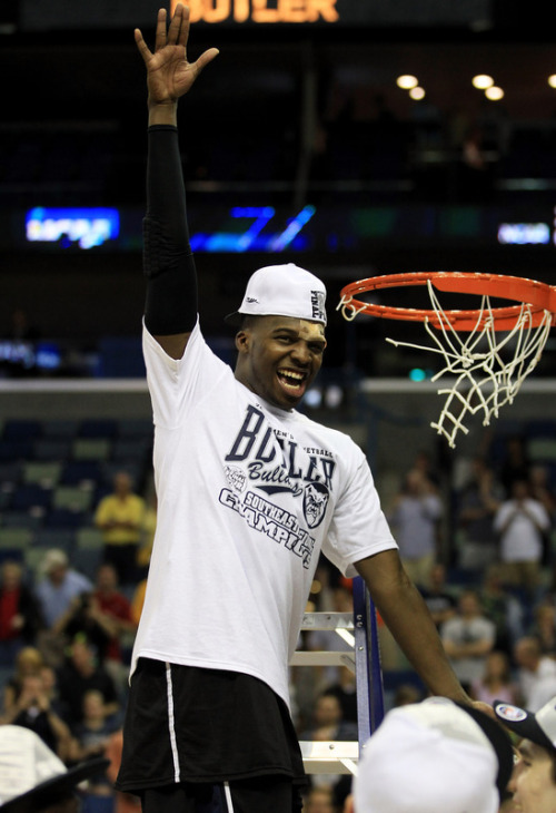Cut Shelvin Mack's forehead, he still cuts down the nets. And look how nicely the championship cap fits him, coming down to just above the wound. It was meant to be. (Photo by Streeter Lecka/Getty Images)