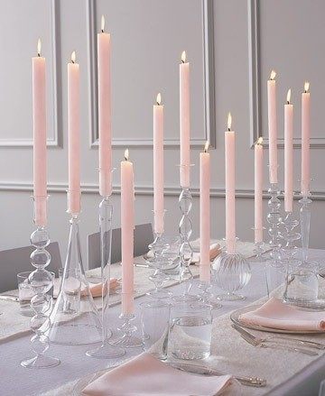 Love the combination of clear glass, white and pale pink, and I like how the candles look like they're floating.