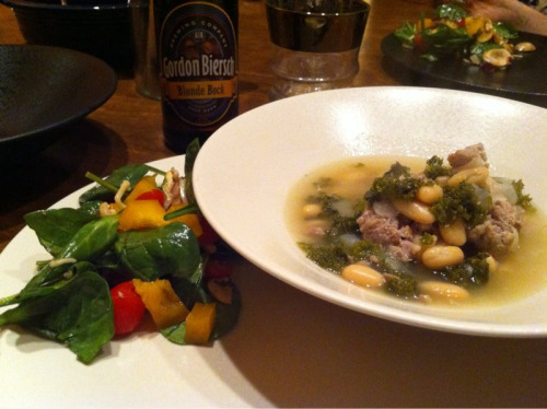 Last night's dinner, part 1: a salad from Kelly, and white bean, sausage and kale soup (6 ingredients, 30 minutes, easy as pie — we sub in italian sausage for the linguica, but it requires adding a bit of extra salt for flavor at the end). Sausage and Bean Soup (Gourmet, via epicurious):   1 tablespoon olive oil 6 ounces kielbasa or linguiça sausage, cut into thin rounds 1 medium onion, chopped 2 3/4 cups canned low-salt chicken broth 1/2 large bunch kale, stems cut away, leaves thinly sliced 1 15-ounce can small white beans, drained 3/4 cup dry white wine Heat oil in heavy large saucepan over medium heat. Add sausage and onion; Sauté until onion is tender, about 6 minutes. Add broth and kale; bring to boil. Reduce heat to medium-low; simmer uncovered 10 minutes. Add beans and wine. Cook until kale is tender, about 10 minutes. Season with salt and pepper.Read More http://www.epicurious.com/recipes/food/views/Sausage-and-Bean-Soup-104148#ixzz1HprW5EjH