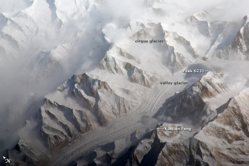 "Central Tien Shan, China The Tien Shan—""celestial mountains"" in Chinese—is one of the largest  continuous mountain ranges in the world, extending approximately 2,500  kilometers (1,550 miles) roughly east-west across Central Asia. This  astronaut photograph provides a view of the central Tien Shan, about 64  kilometers (40 miles) east of where the borders of China, Kyrgyzstan,  and Kazakhstan meet. […]"
