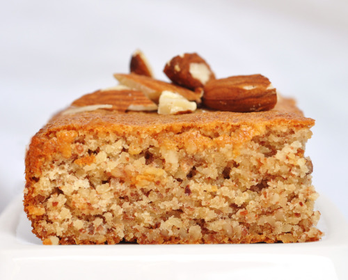 Flourless Almond Honey Cake Ingredients: 1 cups whole almonds, toasted (546) 3 egg whites, at room temperature (48) 1/3 cup honey (344) 1/4 teaspoon salt (0) Topping 1/4 cup sliced almonds, toasted (137) Method:Preheat oven to 175C (350F). Grease or line the bottom of a wide loaf tin with parchment paper. Process toasted whole almonds in a food processor until finely ground. It will make about 1 1/4 cups ground almonds. Combine ground almonds with honey until it has become a thick paste. Set aside.Beat the egg whites with the salt until stiff enough to hold peaks. . Gently fold the egg white into the almond honey mixture. Then transfer to prepared loaf tin. Sprinkle batter with sliced almonds. Bake for 20-25 minutes, until cake has turned golden brown and inserted toothpick comes out clean. Let cool in the tin for 10 minutes. Let cool completely on wire racks. Cut into 8 bars or squares. Each square/bar will have a total of 134 calories.