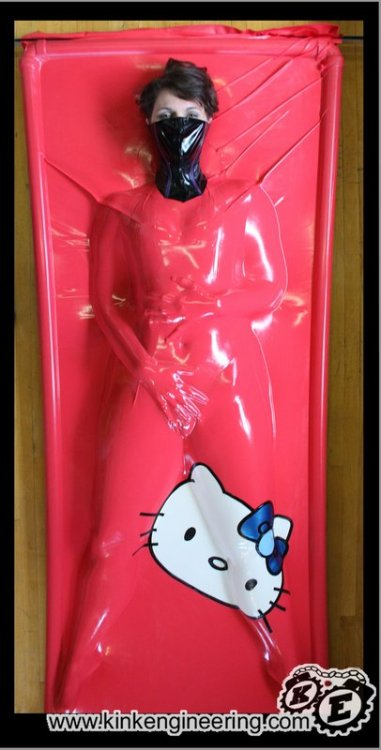 Yes… we made a Hello Kitty Vacbed.  We're on to more adult things now… like PORTAL themed bondage toys. :) stryking:  fuchsiagibson:  Kink Engineering Gallery: Serious Bondage Shoot - Hello Kitty Vacbed  One day, I will try a vacbed. Perhaps this one…