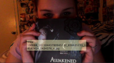 Bella and her copy of Awakened.  If you want to send in fan photos, please email houseofnightseries55@yahoo.com