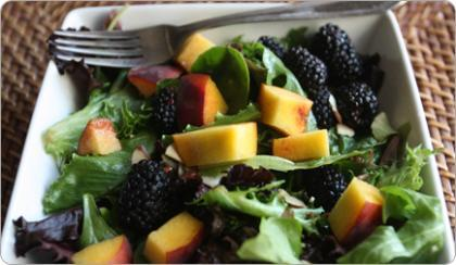 undressedskeleton:  Mixed Green Salad with Peaches & Blackberries in Champagne Vinaigrette Ingredients 2 Tsp champagne vinegar 1 Tsp honey 1 Tsp olive oil 1/2 lb mixed greens 1 cup ripe peaches, diced 1 cup fresh blackberries 1/4 cup sliced almonds  Salt and pepper, to taste Directions Dressing In a small bowl or liquid measuring cup,  combine the champagne vinegar  and honey. While continuing to blend,  slowly drizzle olive oil into the  mixture until the dressing is smooth  and emulsified. Season dressing  with salt and pepper to taste and set  aside until ready to use. To make  ahead, you can also store in the  refrigerator in a covered container for  up to 1 week.  Salad In a large stainless steel bowl, combine the mixed greens, peaches,   blackberries and sliced almonds. Drizzle about 1/2 cup of the   vinaigrette into the bowl and season with salt and pepper. Toss gently   but thoroughly to combine, serve immediately on chilled salad plates. Per serving: 2 cups 113 Calories