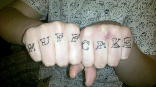 knuckle tats at the kitchen table.