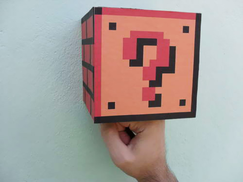 ohryankelley:  Real Life Super Mario Bros Coin Block Instructable user Bruno created this fun real life  Super Mario Bros. coin block, which pops out coins when it's hit  from the bottom - just like it's virtual counterpart! Click through for video.
