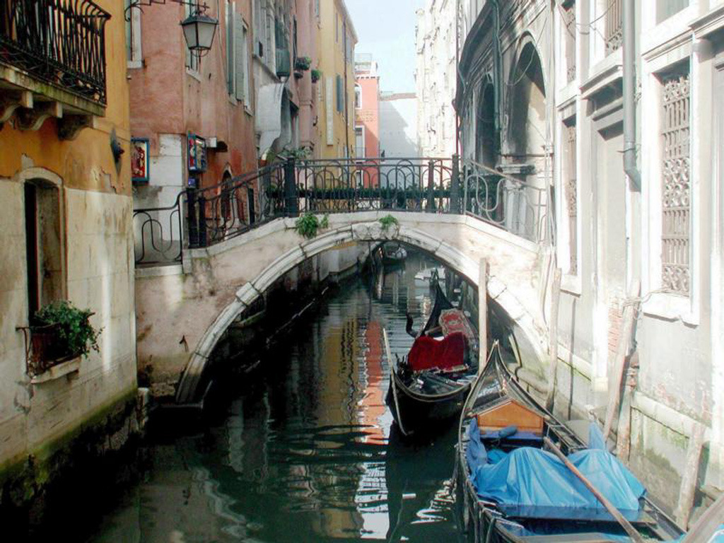 Ahh Venice, from it's renaissance prosperity to it's eighteenth century decline, to today, Venice continues to send out a beacon to tourists of all types. The more I walked around the more I realised; Venice is a city of masks. And that this monochre held true, literally and figuratively.  Around Carnival time you'll see everyone walking around in masks; and they are probably the must have souvenir for tourists (I bought three), in the seventeenth and eighteenth centuries people wore masks in public to protect their anonymity. They came to Venice to do what they couldn't do in Europes other cities. But the city itself wears a mask, from it's glittering facades, literally masking plain brick buildings to it's mask of tourism covering up a city in decline since the eighteenth century. Sure the tourist trade is booming, but what does that mean for real Venetian culture? Is there such a thing? What does the future hold for Venice? Is it sinking as some have often thought, as I wandered down back alleys and winding streets, I thought it would be a shame. A city so beautiful doesn't deserve such a fate.