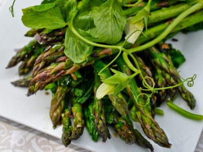Crisp green asparagus with leafy greens, crisp and healthy