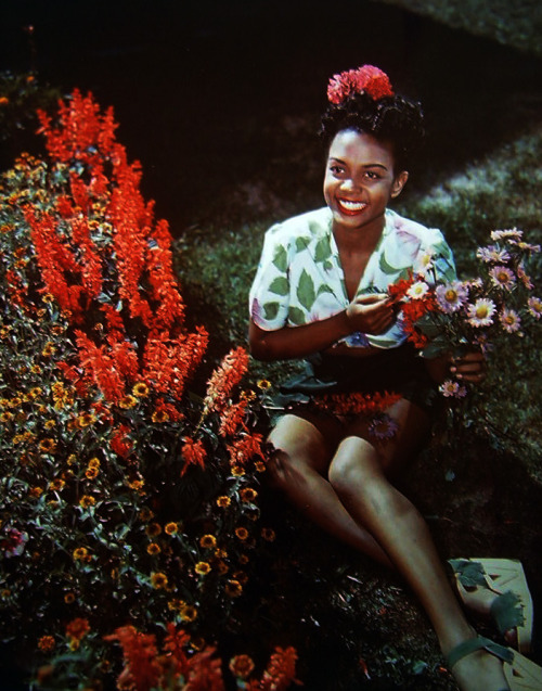 Hazel Scott with flowers and espadrilles.
