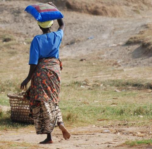 Uganda woman carrying wares on her head