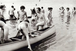 theswingingsixties:  Nude canoeing at Woodstock. 1969.  Photo by Burk Uzzle.
